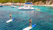 catamaran-anchored-people-stand-up-paddling-corfu-island-[dimensions]-web.jpg